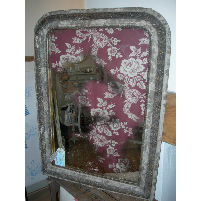 19th Century mirror with antique fabric inlay